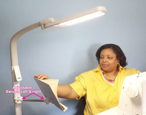 Today, I'm reviewing the OttLite Dual Shade LED Floor Lamp with USB Charging Station. I believe this floor lamp is the perfect addition to your sewing room. The lighting is excellent and adjustable and the adjustable stand is an added bonus. It's provides a place for your smart phone or tablet to view video tutorials as you sew. Also, you never have to worry about your sewing project being interrupted because of a low battery on your device. The floor lamp has its own charging USB charging station.